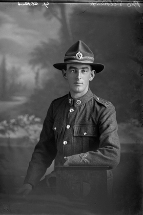 3/4 portrait of Private Thomas Bert Selkirk, Reg No 54713, of the Specialist Company (Machine Gun Section). (Photographer: Herman Schmidt, 1917). Sir George Grey Special Collections, Auckland Libraries, 31-S3487. No known copyright.