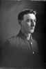 1/4 portrait of Private Thomas Bert Selkirk, Reg No 54713, of the Specialist Company (Machine Gun Section). (Photographer: Herman Schmidt, 1917). Sir George Grey Special Collections, Auckland Libraries, 31-S3488. No known copyright.