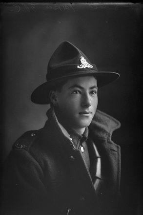 1/4 portrait of Gunner Sinel (probably Philip Mathieson) Reg No 33458, of the Otago Infantry Battalion.  Entry in Schmidt register is for P D Sinel (Photographer: Herman Schmidt, 1917). Sir George Grey Special Collections, Auckland Libraries, 31-S3493. No known copyright.