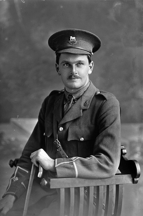 3/4 portrait of 2nd Lieutenant Norman Russell Withiel Thomas, Reg No 20940, of the 24th Reinforcements, - E Company, with collar badges of the New Zealand Signal Corps. (Photographer: Herman Schmidt, 1917). Sir George Grey Special Collections, Auckland Libraries, 31-T3275. No known copyright.