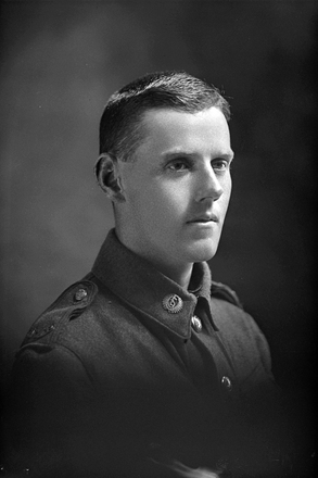 1/4 portrait of Rifleman Norman Warren, Reg No 24/1850, of the New Zealand Rifle Brigade, 2nd Battalion, - F Company. (No F Company in the 9th Reinforcements.) (Photographer: Herman Schmidt, 1915|1916). Sir George Grey Special Collections, Auckland Libraries, 31-W1278. No known copyright.
