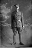 Full length portrait of Lance Corporal (Corporal in the nominal roll) Ralph White, Reg No 14518, of the Auckland Infantry Battalion, - A Company, 14th Reinforcements. Killed in action in France on 4 October 1917 at the Battale of Passchendaele. (Photographer: Herman Schmidt, 1916). Sir George Grey Special Collections, Auckland Libraries, 31-W1309. No known copyright.