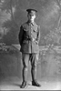 Full length portrait of Trooper K Walker with the New Zealand Mounted Rifles, 24th Reinforcements. (Photographer: Herman Schmidt, 1917). Sir George Grey Special Collections, Auckland Libraries, 31-W2570. No known copyright.