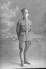 Full length portrait of Trooper Ernest Richard Warnock, Reg No 36020, of the New Zealand Mounted Rifles 24th Reinforcements. (Photographer: Herman Schmidt, 1917). Sir George Grey Special Collections, Auckland Libraries, 31-W2576. No known copyright.