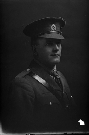1/4 portrait of 2nd Lieutenant Thomas Francis Warren, Reg No 33116, of the New Zealand Rifle Brigade, - J Company. (Photographer: Herman Schmidt, 1917). Sir George Grey Special Collections, Auckland Libraries, 31-W3304. No known copyright.
