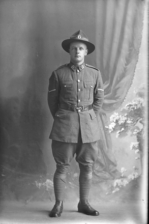 Full length portrait of Lance Corporal (Corporal in the nominal roll) William Leonard Wyber, Reg No 70584, of the 35th Reinforcements, - A Company. (Photographer: Herman Schmidt, ). Sir George Grey Special Collections, Auckland Libraries, 31-W4813. No known copyright.
