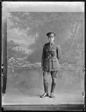 Full length portrait of Lieutenent Foubister wearing World War 1 military uniform and an Air Corps badge (Photographer: Herman Schmidt, ). Sir George Grey Special Collections, Auckland Libraries, 31-WP8062. No known copyright.
