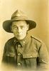 Portrait of 3/483 Ormond Burton in Lance Corporal Uniform in 1916, Field Ambulance, photo at USA Studio, Edgeware Road, London. No Known Copyright.