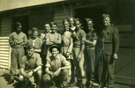11 Members of the Bren Carrier platoon standing in front of building. (Collection of Darcy Gardiner (800706)). Image provided by Brian Gardiner. This image may be subject to copyright.