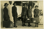 Group, WWII, 5 nurses standing on ship's deck; 4 with suitcases: left to right unknown nurse, unknown nurse, Mary Bernadette Stapleton (married name Crispin) s/n 72052 centre (middle), Joan Katherine Simcock (s/n 72053) 4th from left, and T. Margaret Mountford (s/n 72025) far right, embarking from Wellington 22/12/1941. This image may be subject to copyright.