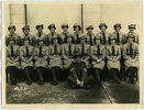 Group portrait, 19 uniformed women and a male Sergeant. Photographers stamp: taken by RJ Thomson photographers, 112 Hamilton Road, Hataitai. No Known Copyright.