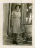 """Portrait, Mary Bernadette Stapleton (married name Crispin) s/n 72052 standing outside next to columns large garden urn. Photograph annotated on reverse """"in Alexandria, Egypt, 15th August 1943"""". No Known Copyright."""