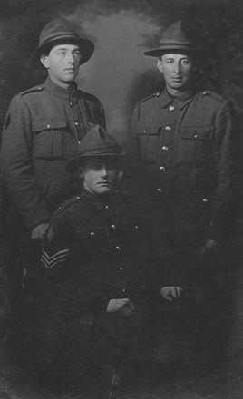 Group portrait. [l-r] Hector Sowry s/n 32241, Leonard Sowry s/n 32242 and (sitting) Eric Arthur Sowry s/n 15790.  Image provided by Macpherson family.  No Known Copyright.