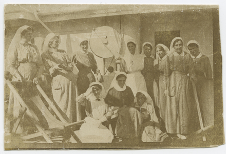 Nurses on board troopship. Mary Gould (standing third from left). Le Gallais family. Auckland War Memorial Museum Library. PH-ALB-2-p25L1. No known copyright restrictions.