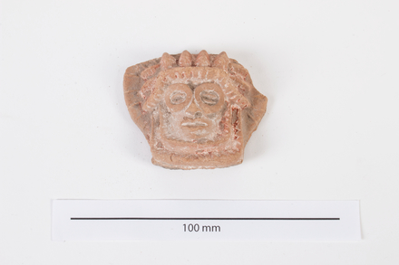 head, figurine 2012.19.479