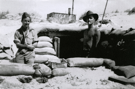 William Sharp (s/n 34491) (left), and another man in front of a sand-bagged dugout. Image provided by family. This image may be subject to copyright.