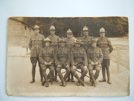 Group portrait. Back row. Sgt. A.W. Maiolon; Sgt. C. Mudford; R.P. S, W. Hogg; C. MacKay. Front row: S/Sgt A.T. Hall; C.S.M. Roebuck; C.A.M.S. Capper, Sgt. Selby. Taken at Codford, England, May 19, 19 [indecipherable date]. Image kindly provided by Hall Family. Image has no known copyright restrictions.