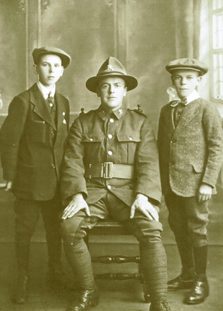 Postcard of studio portrait of Seffried Charles Irons (s/n 21583) sitting between two boys; his future brothers' in law, taken about November 1916. Image kindly provided by Amanda Kerby. Image has no known copyright restrictions.