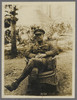 Unknown photographer (1918) A New Zealand Officer. Portrait of an Officer seated in a wicker chair in a garden. He sits with his legs crossed at the knee and his hand resting in his lap. Identified as Colonel Donald Johnstone McGavin. At Divisional Headquarters in Bus-les-artois, France. Auckland War Memorial Museum - Tamaki Paenga Hira. PH-ALB-419-H784. Image has no known copyright restrictions.