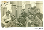 Group of Airmen on board S.S. Arawa, c. October 1917. Edwyn Arnold Fraser Wilding (CAC graduate no. 1) second from right at back, Ross Brodie (CAC graduate no. 9) directly in front of him and possibly Herbert Nelson Hawker (CAC graduate no. 2) to his right (wearing pilot badge). Ernest Taniwha Sutherland (CAC graduate no. 8 and the first M_ori graduate) fourth from left in front (with hat and camera). J. E. Stevens believed to be at extreme left (CAC graduate no. 3) and Clarence James McFadden (CAC graduate no. 4) second from right in front (in front of Brodie). The airmen were on their way from New Zealand to England to begin training with the Royal Flying Corps. From the Edwyn Wilding collection. Airforce Museum of New Zealand (AFM 2007/191.9). Image has no known copyright restrictions.