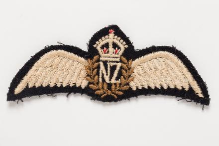 badge, 2001.25.496