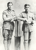 Portrait of Private Mologa Ah Mu (16/1405), 4th Maori Contingent and Private James Swanney (16/1419), 4th Maori Contingent. Portrait taken in Auckland sometime between attestation on 03 February 1916 and departure on 05 May 1916 for the SS Mokoia / HMNZT 52 in Wellington. Photographer: Percival Kingsford Daws (1872-1939), The Crown Studios, 266 Queen Street, Auckland. Image kindly provided from the Christina Heath collection. Image has no known copyright restrictions.