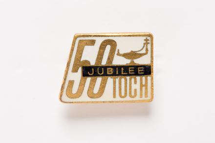 badge, 2001.25.124