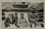 Snapshot of Nurse, Eliza Fitzgerald Martin (22/385) and Lieutenant's Thomas Arthur Blyth (15648) and Charles McLelland Bathgate (22520). The trio are seated on deck chairs on board HMNZT 71 SS Port Lyttelton. Erson Album. Auckland War Memorial Museum, Tāmaki Paenga Hira PH-ALB-461-p1-1.Image has no known copyright restrictions.