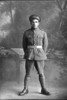 Full length portrait of Private Edmund Duffy. (Photographer: Herman Schmidt, 1916). Sir George Grey Special Collections, Auckland Libraries, 31-D1527. No known copyright.