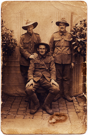 Photograph of three men in uniform, John Joseph Wakefield (s/n 8/3106) in standing on the left. Image kindly provided by Annie Kiddle(nee Wakefield).Image has no known copyright restrictions.