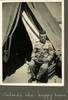 """Man in military uniform sitting in front of tent, """"Outside the 'happy home'"""", Photo Album in Egypt of 638 Charles Honori Parks. Image kindly provided by Parks family. Image has no known copyright restrictions."""