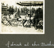 """Three men in swimming attire posing in the shade of an umbrella, """"A drink at the Baths"""", Photo Album in Egypt of 638 Charles Honori Parks. Image kindly provided by Parks family. Image has no known copyright restrictions."""