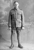 Full length portrait of Private Jack Ravlich, Reg No 12/3790 (Photographer: Herman Schmidt, 1916). Sir George Grey Special Collections, A, of the Canterbury Infantry Battalion, 8th Reinforcements. (Photographer: Herman Schmidt, 1916). Sir George Grey Special Collections, Auckland Libraries. No known copyright restriction.