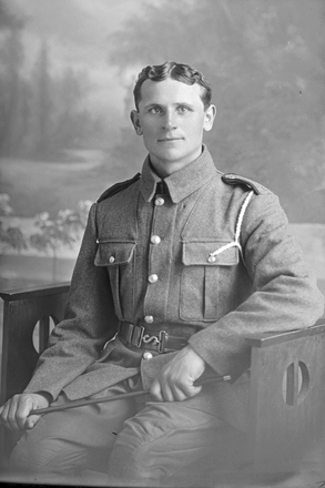 3/4 portrait of Private Jack Ravlich, Reg No 12/3790(Photographer: Herman Schmidt, 1916). Sir George Grey Special Collections, Auckland Libraries. No known copyright restriction.