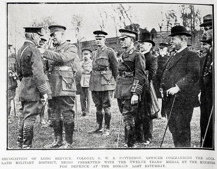 Recognition of long service: Colonel G. W. S. Patterson, officer commanding the Auckland Military District, being presented with the Twelve Years' Medal by the Minister for Defence at the Domain last Saturday. Taken from the supplement to the Auckland Weekly News 28 September 1916 p038. Sir George Grey Special Collections, Auckland Libraries, AWNS-19160928-38-2. No known Copyright.