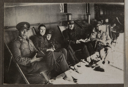 Unknown, photographer (1914-1918). Five service personnel on board RMS Rotorua. Pirimi Tahiwi first on the left holds camera. Auckland War Memorial Museum - Tāmaki Paenga Hira, A. G. Macdonald Album 2 PH-ALB-546-p24-8. Image has no known copyright restrictions.
