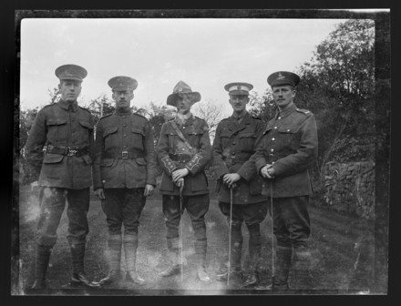 Cooper, William Saunderson, 1916-1917, Shepshed. Captain William Saunderson Cooper and brothers at Shepshed. Portrait of Captain William Saunderson Cooper (centre, in lemon squeezer hat) with four other soldiers, some of whom appear to be from British regiments. The portrait was taken when Cooper was on invalid leave in England between late 1916 and early 1917. Gift of Andrew Cooper, 2001. Te Papa (B.068484). Image have no known copyright restrictions.