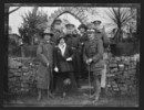 Captain William Saunderson Cooper with brothers and two women, at Shepshed, 1916-1917, Shepshed, by William Saunderson Cooper. Portrait of Captain William Saunderson Cooper (on left, in lemon squeezer hat) with four other soldiers, and two women. The portrait was taken when Cooper was on invalid leave in England between late 1916 and early 1917. Gift of Andrew Cooper, 2001. Te Papa (B.068483). Image has no known copyright restrictions.
