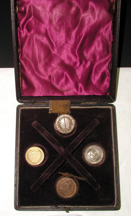 medals (4) and box (col.3177) view of medals inside box