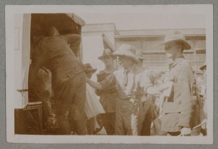 """Unknown, photographer (1915-1916). """"Patients entering ambulances for NZ. Sg. Major Duncan, Sgt. Sandstein"""". [Agnes (Peggy) Williams photograph album]. Auckland War Memorial Museum - Tāmaki Paenga Hira PH-2017-2-2-p26-7. No known copyright restrictions."""