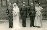 Group photograph of Private John O'Brien, Dorothy Williams, Reverend Captain H.I. Hopkins, Corporal James Randel Heron and Joan Campbell on the wedding day of John and Dorothy, 17 November 1939 at St. Peter's Anglican Church, Timaru. Image kindly provided by John's daughter Susan Sexton (October 2017). Image has no known copyright restrictions.