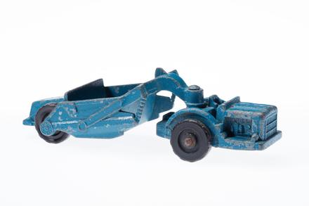toy tractor (scraper)