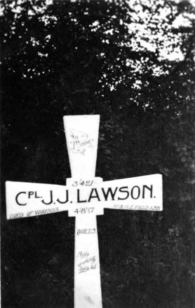 Wooden grave site marker for Corporal Joseph Johnstone Lawson, No.2 New Zealand Field Ambulance, WWI. Died of wounds at age twenty-three, 4 August 1917. Burial location recorded as Trois Arbres Cemetery Steenwerck, Nord, France. Photograph (ref: PHO2006-039) held by Puke Ariki Museum, New Plymouth, New Zealand : pukeariki.com - No known copyright restrictions.