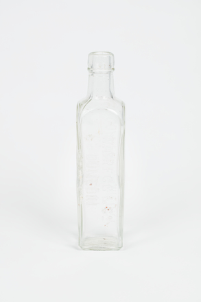 bottle, coffee essence, 1997.80.41, Photographed by Richard Ng, digital, 08 Oct 2018, © Auckland Museum CC BY