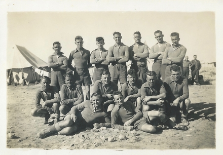 Group photograph of No 2 Section, team that played HQ and lost 7-3. Back: Ron McKay, Bill Adams, Dick Bolderston, Tom Tietjens, Bill Purves, Wally Johnson, Mich Bercich. Middle: Jim Elder, Herb Gregory, Mick Quinn, Dick Durry, Len Jackson, Chriestensen. Front: Jack Porter, Stan Fraser. Image kindly provided by Margaret Riordan. Image may be subject to copyright restrictions.