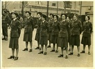 Group photograph of Women's Auxiliary Air Force Victory Contingent, Front Row L to R: S/sgt J L Copeland, Sgt J S Milne, Cpl E M Tuapawa, Sgt. C E Reid. Middle Row, WAL E J McGovern, Sgt N C Mercer, Cpl J Beasley, Back Row. Sgt. C F Bryers, Cpl J Mitford-Taylor, Sgt J M Gerrie. Image kindly provided by Jenny Scott (April 2019). Image may be subject to copyright restrictions.