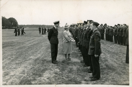 Photograph of 487 Squadron, Royal Air Force, being inspected by King George VI and Queen Elizabeth (later The Queen Mother) at RAF Methwold, Norfolk. Robert Pye is standing 'this end of the photo'. Image kindly provided by Robert Pye (1997). Image may be subject to copyright restrictions.