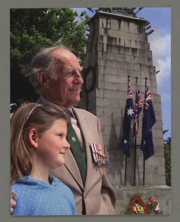 Photograph of Brian Abbott and his granddaughter on Anzac Day, published in the Waikato Times. Image kindly provided by Brian Abbott (2006). Image subject to copyright restrictions.