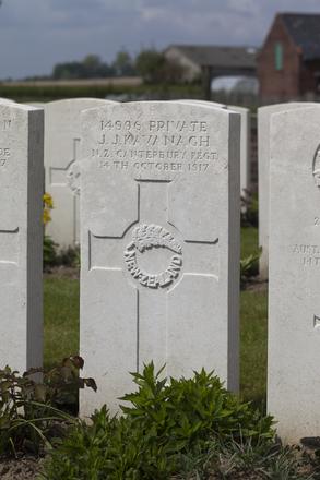 Headstone of Private James Joseph Kavanagh (14996). Nine Elms British Cemetery, Poperinge, West-Vlaanderen, Belgium. New Zealand War Graves Trust (BEDA9494). CC BY-NC-ND 4.0.