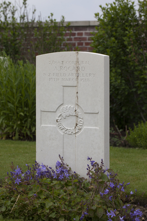 Headstone of Shoeing Smith Corporal Amede Rocard (2/1667). The Huts Cemetery, Ieper, West-Vlaanderen, Belgium. New Zealand War Graves Trust (BEEE1355). CC BY-NC-ND 4.0.